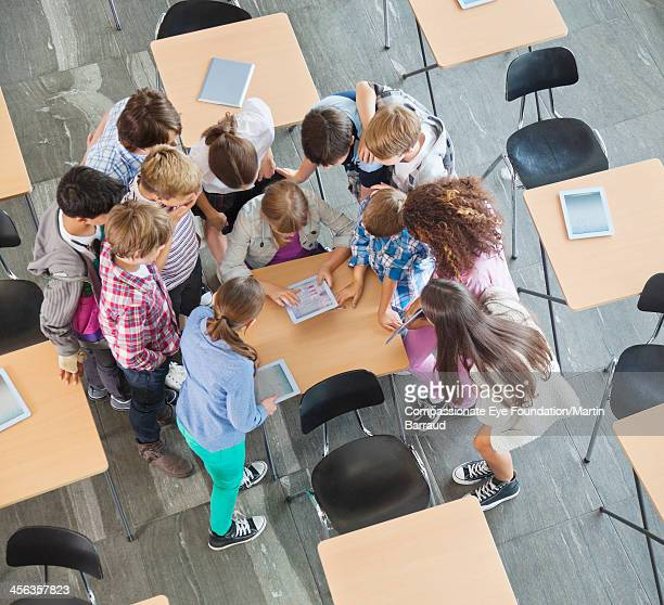 Students using digital tablets in classroom