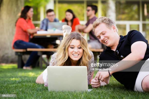 Students using laptop on college campus
