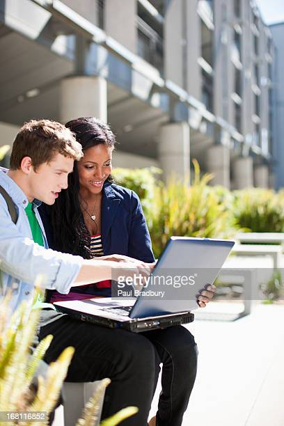 Students using laptop outdoors