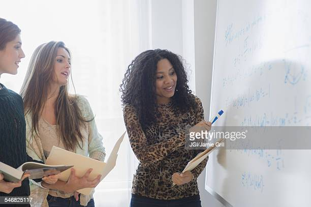 Students using whiteboard in classroom
