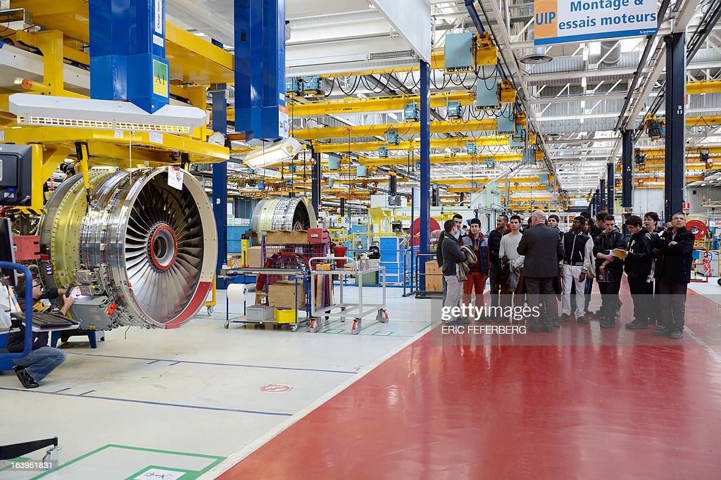 Students visit the assembly halls of French aerospace and defence group Safran, manufacturing engines for commercial and military aircraft, on March 18, 2013 at the SNECMA Villaroche site in Moissy-Cramayel, south east of Paris.
