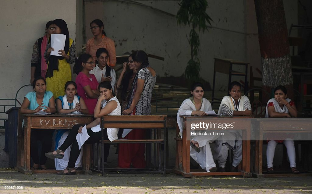 Students waits after they were thoroughly scanned to take the All India Pre-Medical/Pre-Dental Entrance Test (AIPMT) at the examination centre at RK Puram on May 1, 2016 in New Delhi, India. The All Indian Pre-Medical Test (AIPMT) 2016, being treated as the first phase of the National Eligibility Entrance Test (NEET), was held on Sunday. The competitive examination held for entrance to MBBS and BDS courses across the country was held amidst tight security this year. Students had a proper dress code to adhere to as they were not allowed to enter the examination hall in shoes or carry any kind of stationary with them. Mobile phones were also not allowed