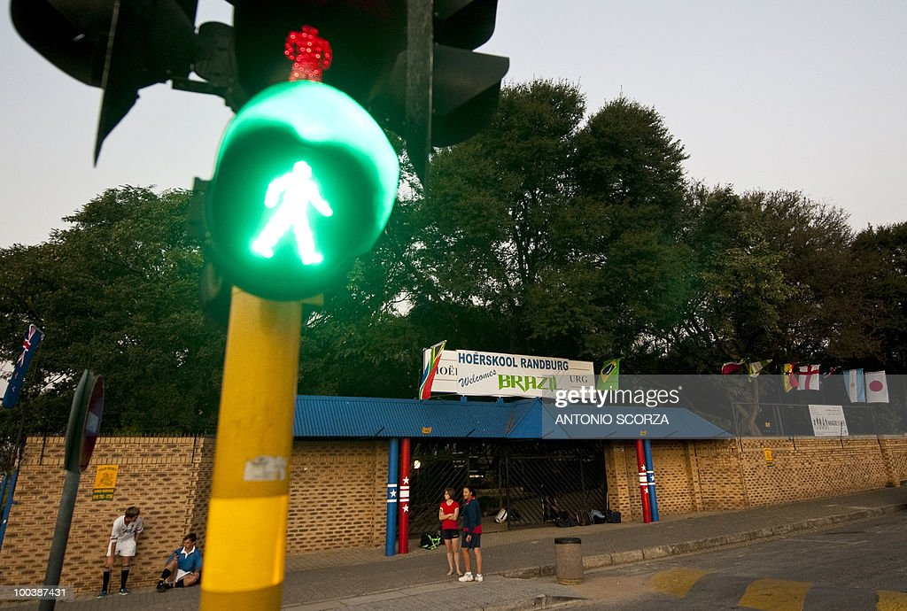 Students wait for a traffic light at the entrance of the Hoërskool Randburg high school, where Brazil's national soccer tem will practice preparing to dispute the 2010 FIFA South Africa World Cup, on May 24th, 2010 in Johannesburg, South Africa.