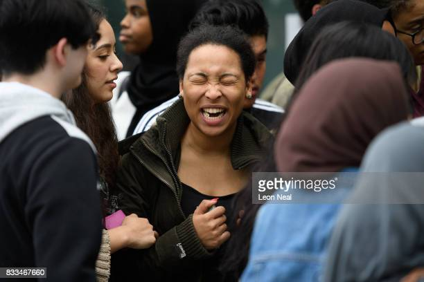 Students wait in line before receiving their A level results at City and Islington College on August 17 2017 in London England The number of students...