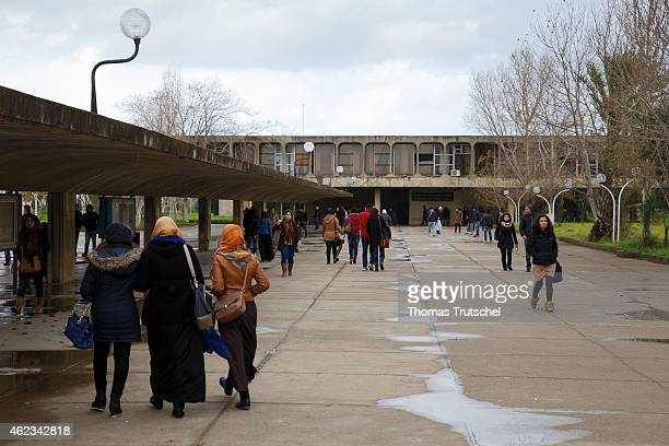 Students walk across campus of University of Sciences and Technology Houari Boumediene in January 25 2015 in Algiers Algeria The university buildings...
