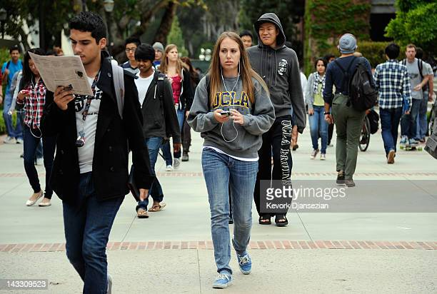 Students walk across the campus of UCLA on April 23 2012 in Los Angeles California According to reports half of recent college graduates with...