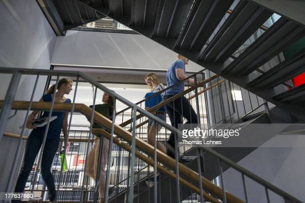 Students walk down stairs in the library of the Faculty of Business and Administration of the University of Mannheim on August 12 2013 in Mannheim...
