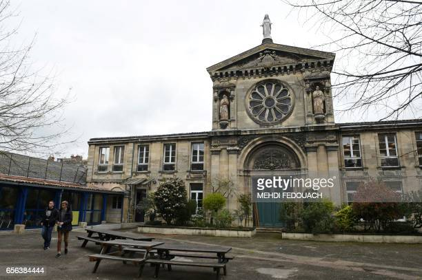 Students walk in front of the Le Mirail High School in Bordeaux southwestern France on March 20 2017 This nonstandard high school follows the program...