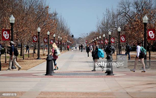 Students walk on campus between clases at the University of Oklahoma on March 11 2015 in Norman Oklahoma Video showing Sigma Alpha Epsilon members...