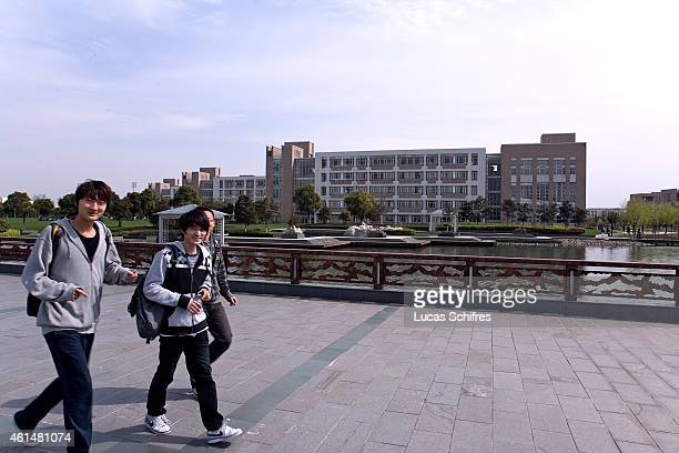 Students walk on the campus of Shanghai University of Engineering Science in the outskirts on April 7 2010 in Shanghai China