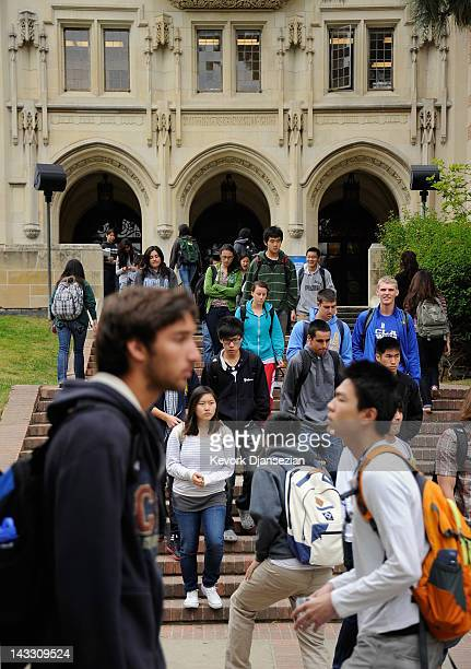 Students walk on the campus of UCLA on April 23 2012 in Los Angeles California According to reports half of recent college graduates with bachelor's...