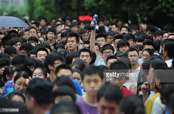 Students walk out from a schoolyard after finishing the first subject of the 2013 university entrance exam in Hefei north China's Anhui province on...