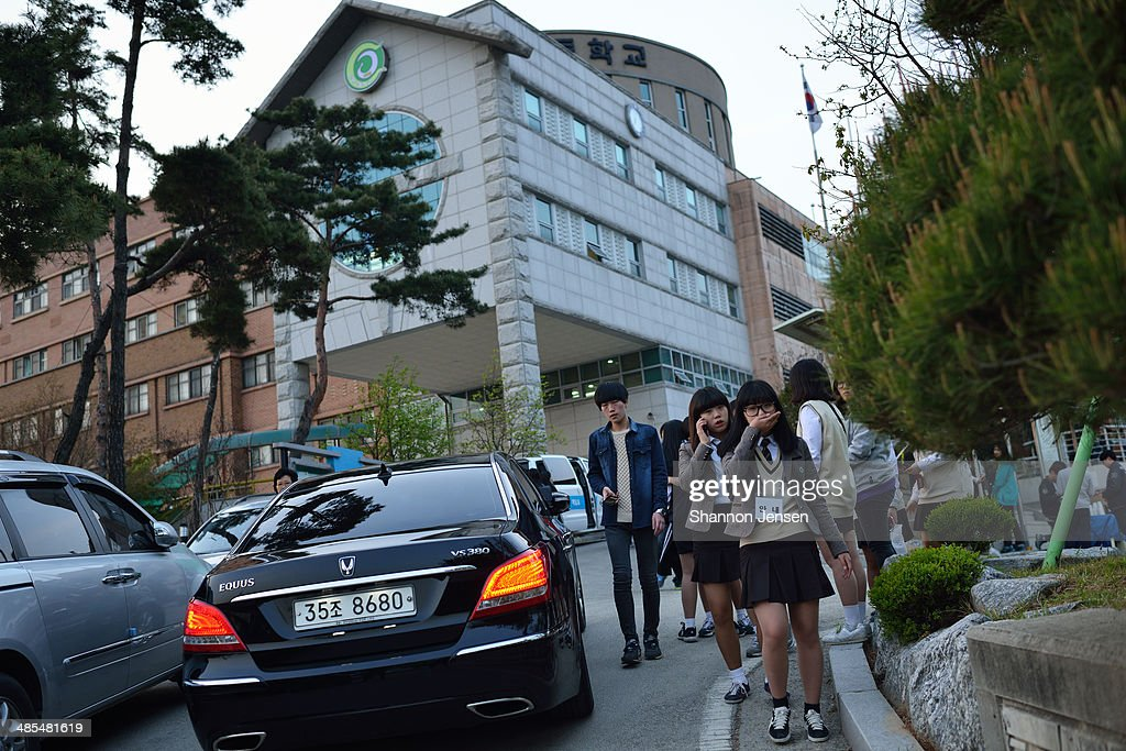 Students walk out of Danwon High School on April 18, 2014 in Ansan, South Korea. 325 students and 15 teachers of Danwon High School on a school trip were among the 477 passengers on board the ferry capsized off of Jindo Island in South Korea on April 16, 2014.