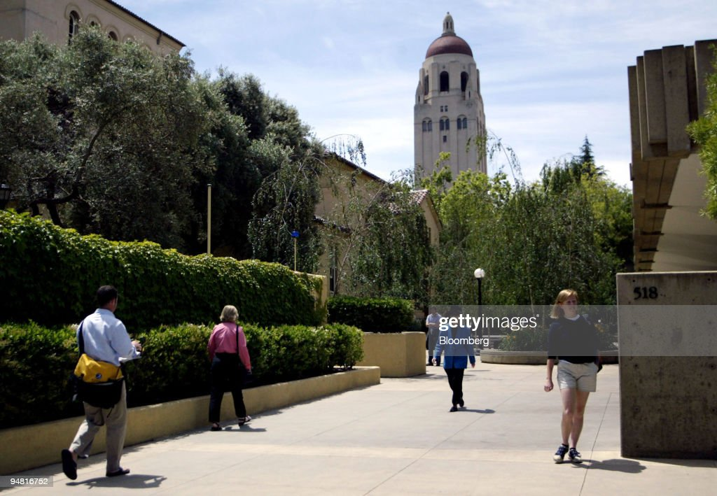 Students walk past Stanford University's Graduate School of Business in Stanford California on May 27 2004 In the distance is campus landmark Hoover...