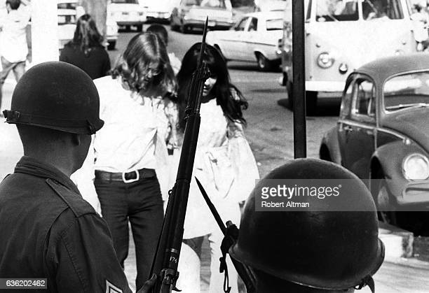 Students walk through People's Park as guards hold their riffles circa May 1969 in Berkeley California