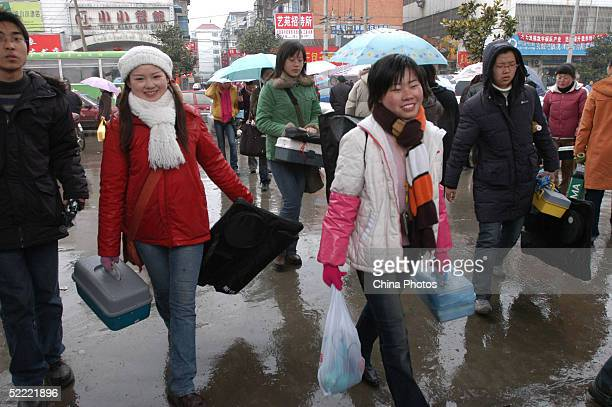 Students walk to an exam room for entrance examinations of art academies in Anhui Province on February 19 2005 in Hefei of Anhui Province China There...