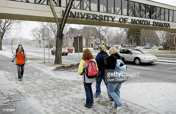 Students walk to class on the campus of the University of North Dakota December 4 2003 in Grand Forks North Dakota UND student Dru Sjodin was last...