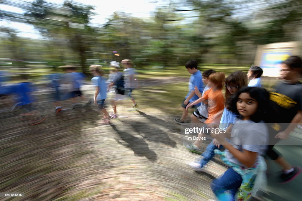 Students walk to lunch during the unveiling of WaterVentures, Florida's Learning Lab at Crystal Springs Preserve in partnership with Zephyrhills Brand 100% Natural Spring Water on January 9, 2013 in Crystal Springs, Florida.
