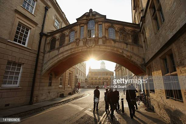 Students walk under the Bridge of Sighs along New College Lane on March 22 2012 in Oxford England