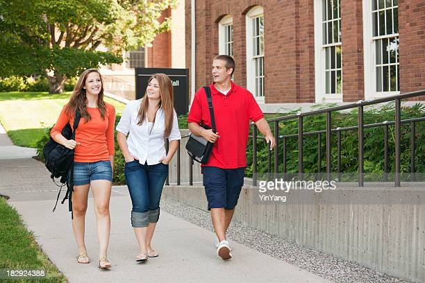 Students Walking by University Campus College Dorm, Talking about School