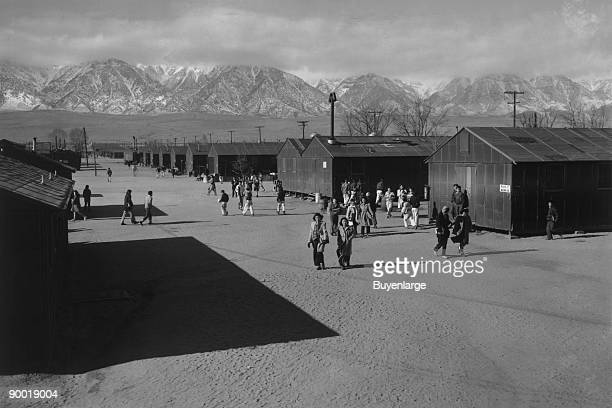 Students walking in road between buildings Ansel Easton Adams was an American photographer best known for his blackandwhite photographs of the...