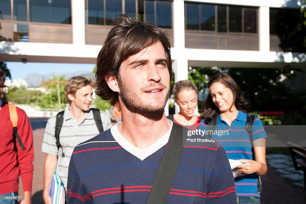 Students walking on a campus : Stock Photo