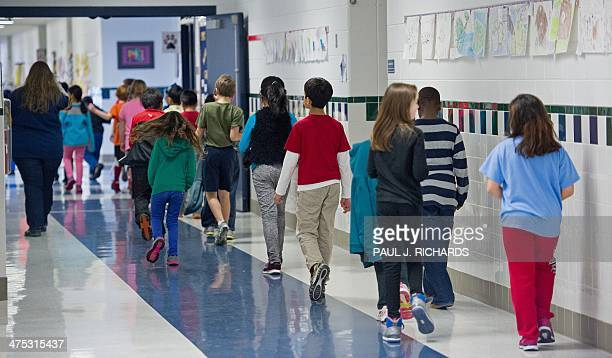 Students walking the hallways are seen February 21 at Steuart W Weller Elementary School in Ashburn Virginia AFP PHOTO/Paul J Richards