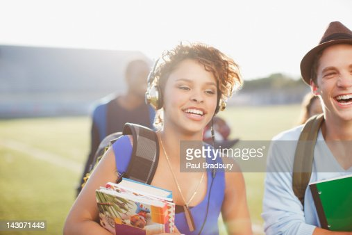 Students walking together outdoors : Stock Photo