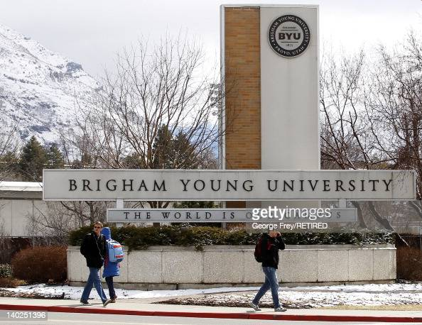 Students walks past the entrance of Brigham Young University on March 1 2012 in Provo Utah BYU is the alma mater of Republican US presidential...