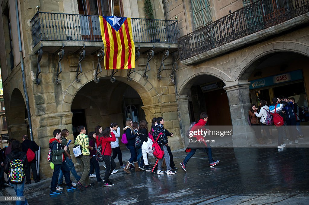 Students walks underneath a pro-independent Catalonia flag hung on the town hall's balcony on November 20, 2012 in Vic, Spain. Catalans will be voting in Parliamentary elections on November 25.