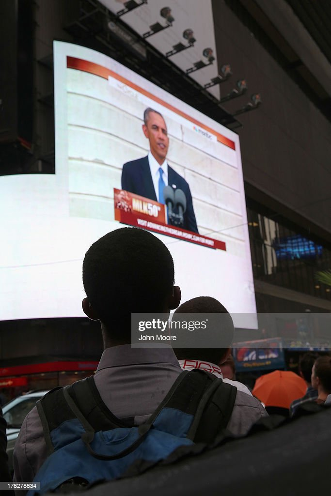 Students watch a giant screen in Times Square as U.S. President <a gi-track='captionPersonalityLinkClicked' href=/galleries/search?phrase=Barack+Obama&family=editorial&specificpeople=203260 ng-click='$event.stopPropagation()'>Barack Obama</a> speaks on the 50th anniversary of Martin Luther King Jr.'s 'I Have a Dream' speech on August 28, 2013 in New York City. With the official ceremony in Washington D.C., a crowd gathered in Manhattan's Times Square to watch the President's speech broadcast live and commemorate the anniversary of what is seen as one of the most important days in the history of American civil rights.