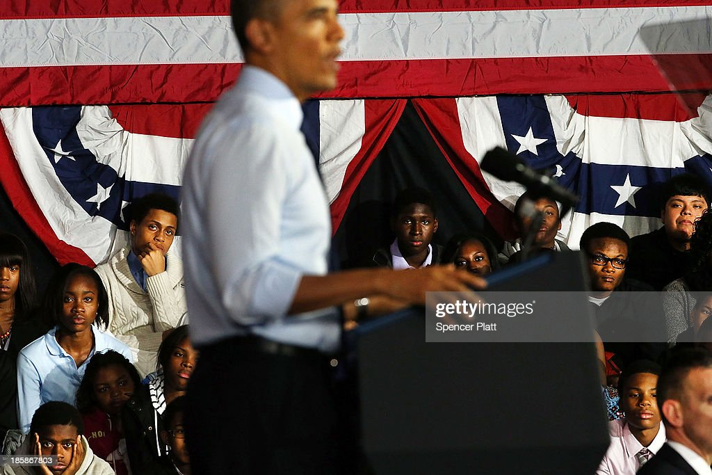 Students watch as U.S. President <a gi-track='captionPersonalityLinkClicked' href=/galleries/search?phrase=Barack+Obama&family=editorial&specificpeople=203260 ng-click='$event.stopPropagation()'>Barack Obama</a> speaks at the Pathways in Technology Early College High School in the Crown Heights section of Brooklyn on October 25, 2013 in New York City. President Obama had mentioned the school in a part of Brooklyn that's struggled with poverty and violence during his State of the Union address in February. While in New York Obama will also attend events to raise money for the Democratic National Committee and Democratic Congressional Campaign Committee.