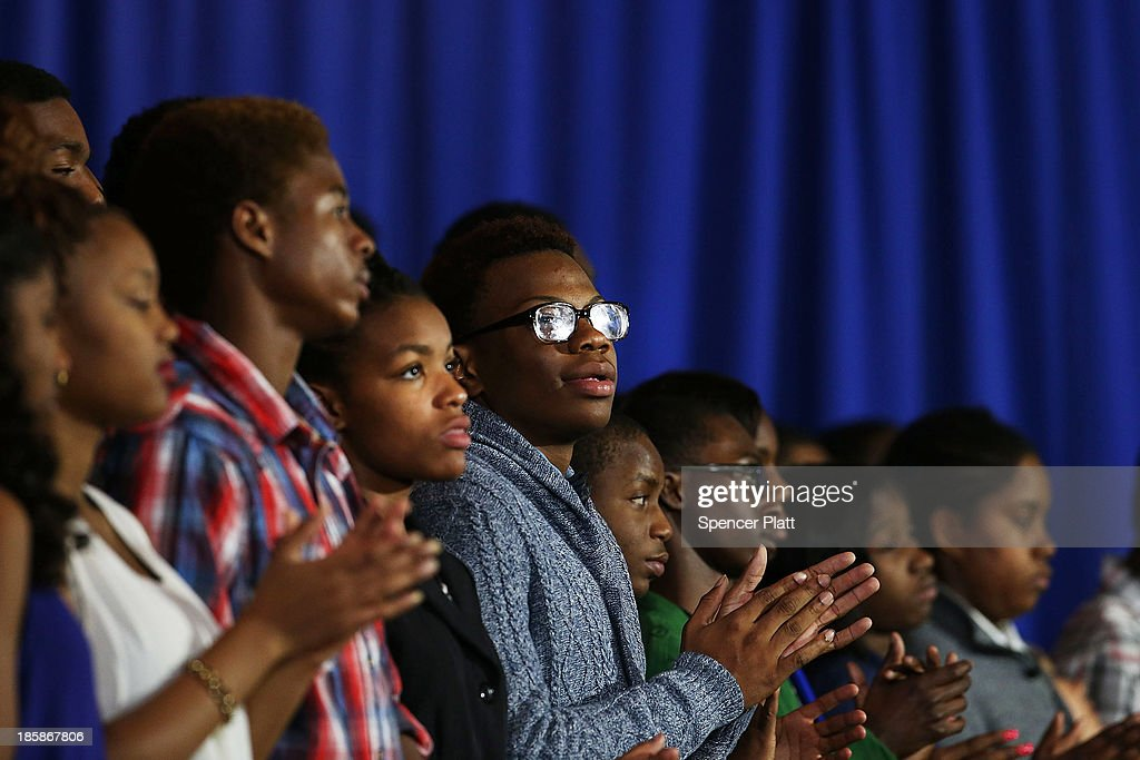 Students watch as U.S. President Barack Obama speaks at the Pathways in Technology Early College High School in the Crown Heights section of Brooklyn on October 25, 2013 in New York City. President Obama had mentioned the school in a part of Brooklyn that's struggled with poverty and violence during his State of the Union address in February. While in New York Obama will also attend events to raise money for the Democratic National Committee and Democratic Congressional Campaign Committee.