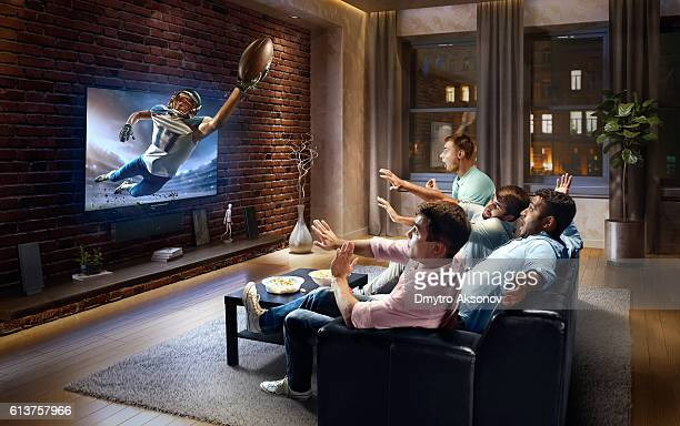 Students watching very realistic American football game on TV