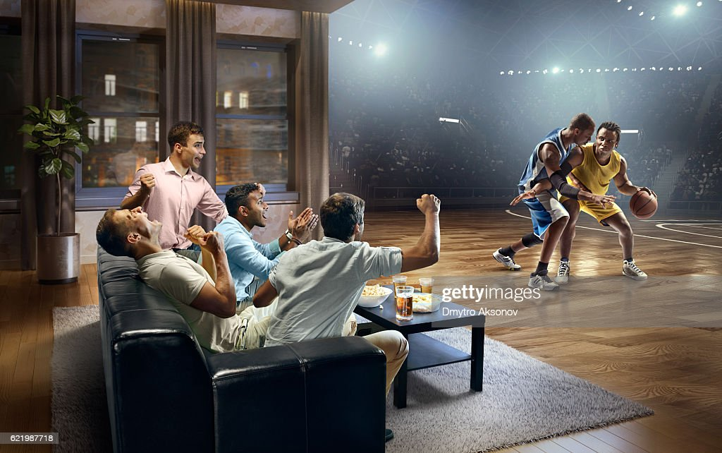 Students watching very realistic Basketball game at home : Stock Photo