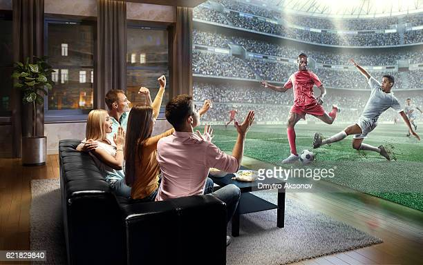 Students watching very realistic Soccer game on TV