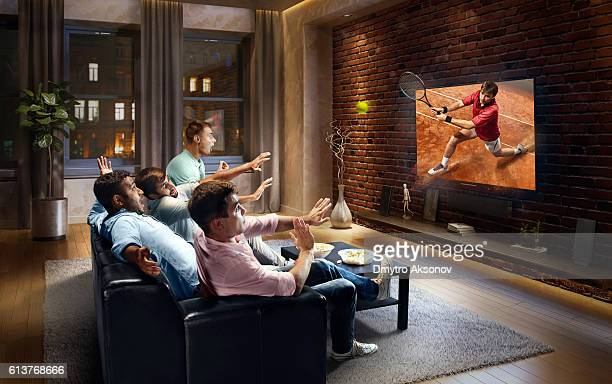 Students watching very realistic Tennis game on TV