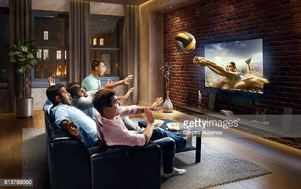 Students watching very realistic Volleyball game on TV