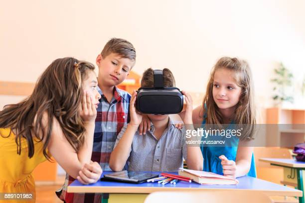 Students watching VR presentation with VR headset