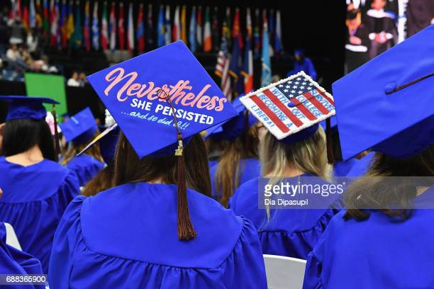 Students wear decorated graduation caps during The Fashion Institute of Technology's 2017 Commencement Ceremony at Arthur Ashe Stadium on May 25 2017...