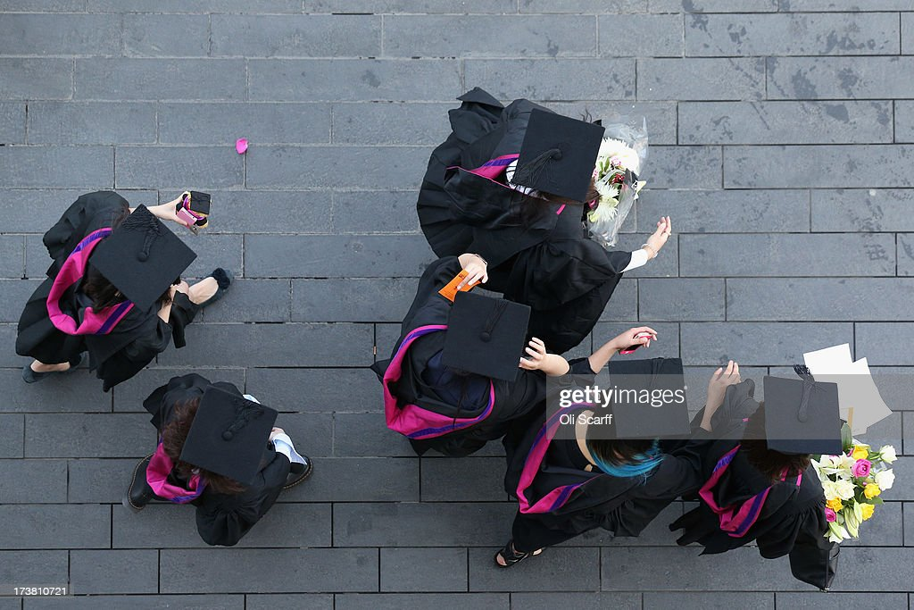 Students wear gowns and mortarboards as they prepare to attend their graduation ceremony in the Royal festival Hall on the Southbank on July 18, 2013 in London, England. The United Kingdom is experiencing a second week of heatwave conditions.
