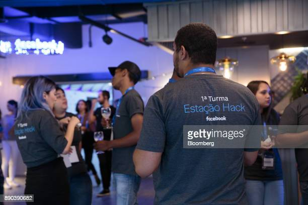 Students wear shirts that read 'The 1st Class' at the Facebook Inc Hack Station in Sao Paulo Brazil on Monday Dec 11 2017 The Facebook Hack Station...