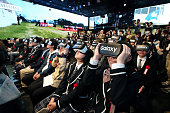 Students wearing virtual reality headsets watch a video broadcast from N High School's main campus in Okinawa Prefecture at an entrance ceremony held...
