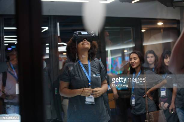 A students wears a virtual reality headset at the Facebook Inc Hack Station in Sao Paulo Brazil on Monday Dec 11 2017 The Facebook Hack Station is...
