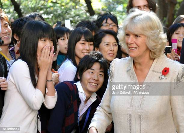 Students welcome the Duchess of Cornwall to Keio University in central Tokyo this morning