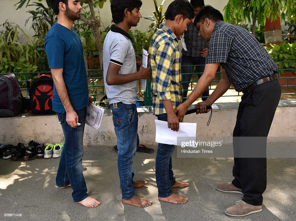 Students were thoroughly scanned who come to take the All India Pre-Medical/Pre-Dental Entrance Test (AIPMT) at the examination centre at RK Puram on May 1, 2016 in New Delhi, India. The All Indian Pre-Medical Test (AIPMT) 2016, being treated as the first phase of the National Eligibility Entrance Test (NEET), was held on Sunday. The competitive examination held for entrance to MBBS and BDS courses across the country was held amidst tight security this year. Students had a proper dress code to adhere to as they were not allowed to enter the examination hall in shoes or carry any kind of stationary with them. Mobile phones were also not allowed
