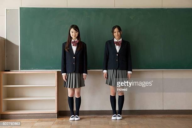 2 students who make a pose