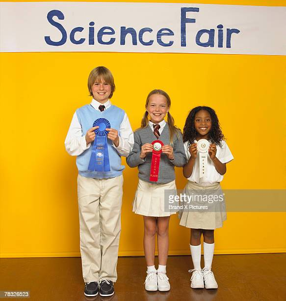 Students with science fair prizes
