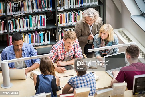 Students With Teacher Learning In Library