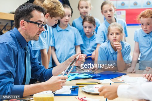 Students With Their Teacher in Science Class
